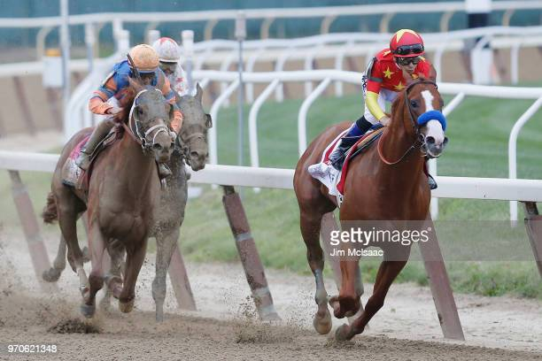 Justify ridden by jockey Mike Smith leads the field around the 4th turn during the 150th running of the Belmont Stakes at Belmont Park on June 9 2018...