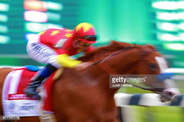 Justify ridden by jockey Mike Smith leads the field to the finish line to win the 150th running of the Belmont Stakes at Belmont Park on June 9 2018...