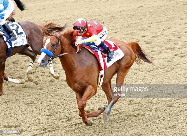 Justify ridden by jockey Mike Smith starts to win the 150th running of the Belmont Stakes at Belmont Park on June 9 2018 in Elmont New York Justify...