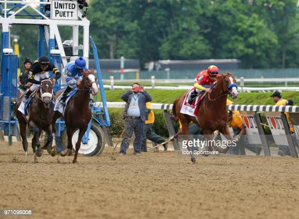 Justify ridden by Jockey Mike Smith takes the lead out of the gate before on his way to winning the 150th running of the Belmont Stakes and with it...