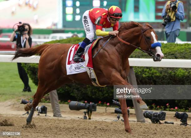 Justify ridden by Jockey Mike Smith wins the 150th running of the Belmont Stakes and with it thoroughbred horse racing's 'Triple Crown' on June 9...
