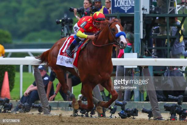 Justify ridden by Jockey Mikle Smith leaves the starting Gate on his way to winning the 150th Belmont Stakes and the Triple Crown on June 9 2018 at...