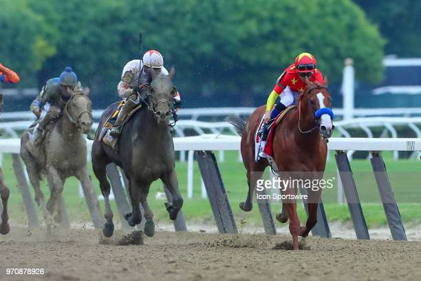Justify ridden by Jockey Mikle Smith runs down the stretch on his way to winning the 150th Belmont Stakes and the Triple Crown on June 9 2018 at...