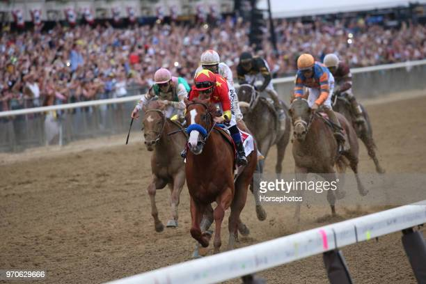 Justify with Mike Smith up wins the Belmont Stakes and Triple Crown for trainer Bob Baffert at Belmont Park Racetrack on June 09 2018 in Elmont New...