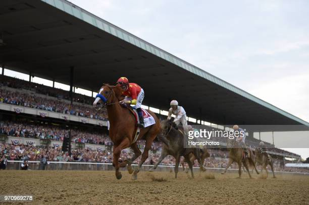 Justify with Mike Smith up wins the Belmont Stakes and Triple Crown at Belmont Park Racetrack on June 9 2018 in Elmont New York