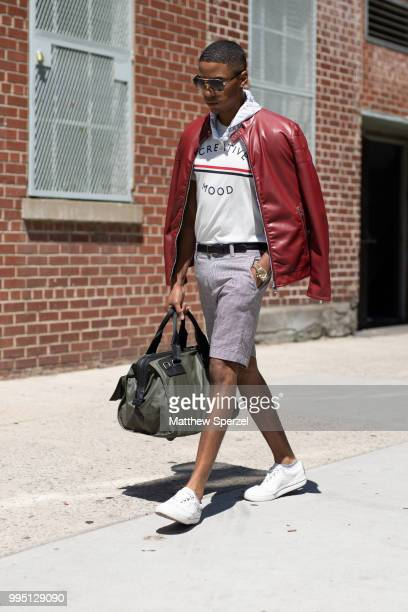 Justiin Davis is seen on the street attending Men's New York Fashion Week wearing Zara with Dolce, Diesel, Michael Kors on July 9, 2018 in New York...