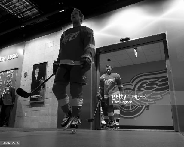 Justin Abdelkader and Henrik Zetterberg of the Detroit Red Wings walk out of the locker room to the ice prior to warmups before an NHL game against...