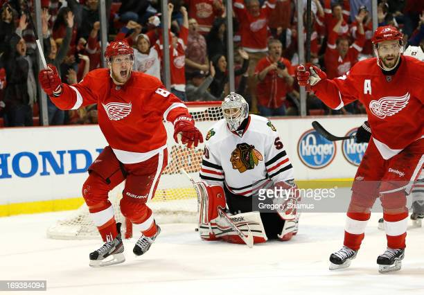 Justin Abdelkader and Pavel Datsyuk of the Detroit Red Wings celebrate a second period goal by teammate Jakub Kindl in front of Corey Crawford of the...