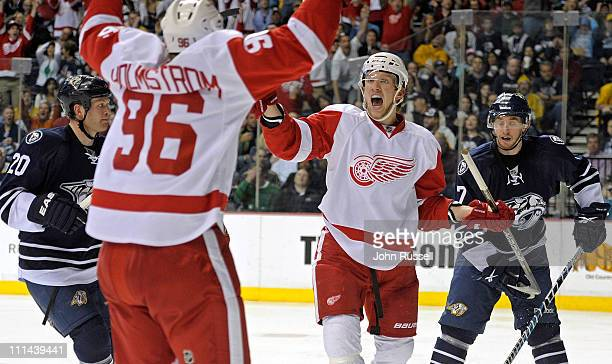 Justin Abdelkader celebrates his goal with Tomas Holmstrom of the Detroit Red Wings against the Nashville Predators during an NHL game on April 2...