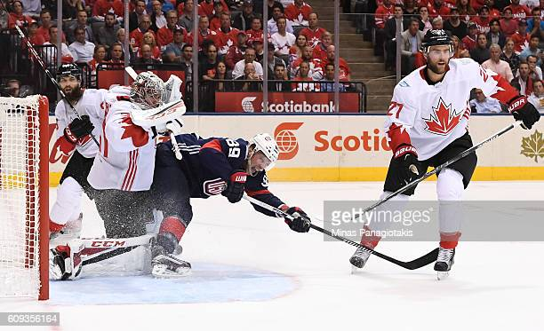 Justin Abdelkader of Team USA collides with Carey Price of Team Canada during the World Cup of Hockey 2016 at Air Canada Centre on September 20 2016...