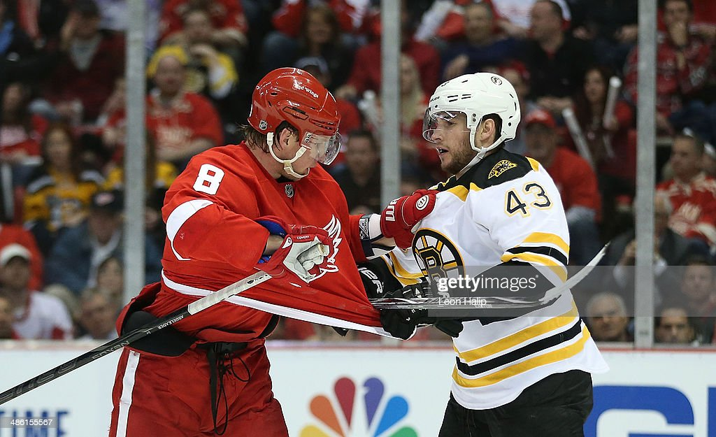 Justin Abdelkader #8 of the Detroit Red Wings and Matt Bartkowski #43 of the Boston Bruins battle during the second period of Game Three of the First Round of the 2014 NHL Stanley Cup Playoffs at Joe Louis Arena on April 22, 2014 in Detroit, Michigan.