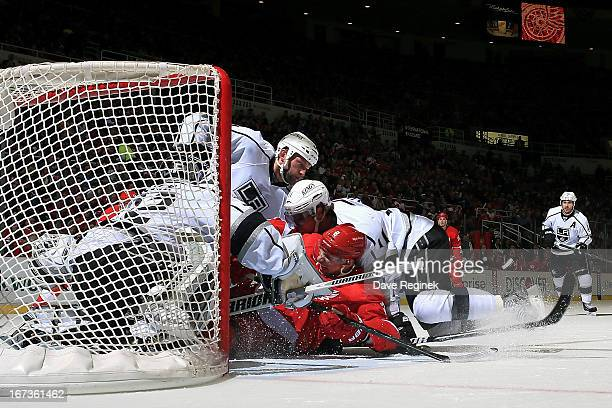 Justin Abdelkader of the Detroit Red Wings Anze Kopitar and Robyn Regehr of the Los Angeles Kings all slide into goalie Jonathan Quick during a NHL...