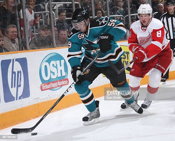 Justin Abdelkader of the Detroit Red Wings attempts to stick check the puck away from Brad Staubitz of the San Jose Sharks during an NHL game on...