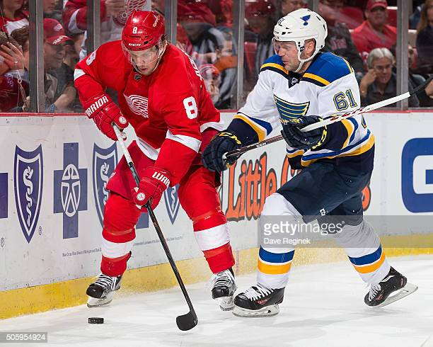 Justin Abdelkader of the Detroit Red Wings battles along the boards for the puck with Andre Benoit of the St Louis Blues during an NHL game at Joe...