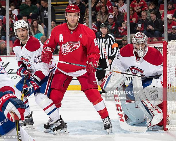 Justin Abdelkader of the Detroit Red Wings battles for position with Mark Barberio of the Montreal Canadiens in front of Carey Price of the Canadiens...