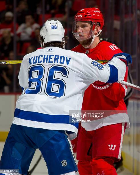 Justin Abdelkader of the Detroit Red Wings battles for position with Nikita Kucherov of the Tampa Bay Lightning during an NHL game at Little Caesars...