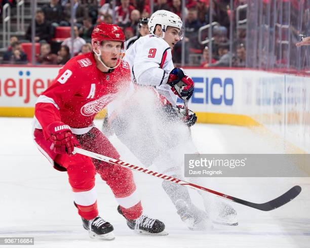 Justin Abdelkader of the Detroit Red Wings battles for position with Dmitry Orlov of the Washington Capitals during an NHL game at Little Caesars...
