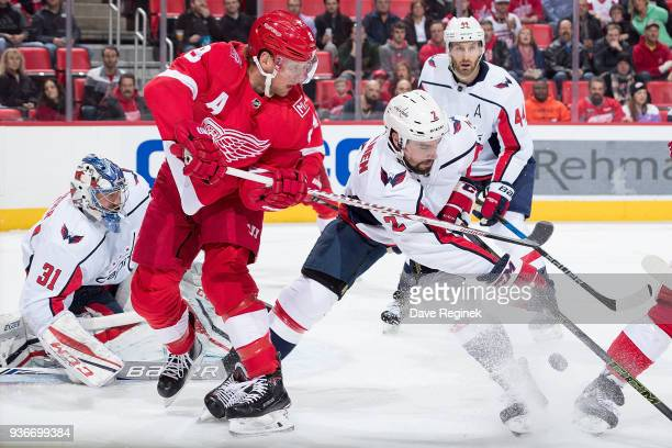 Justin Abdelkader of the Detroit Red Wings battles for the puck with Matt Niskanen of the Washington Capitals in front of goaltender Philipp Grubauer...