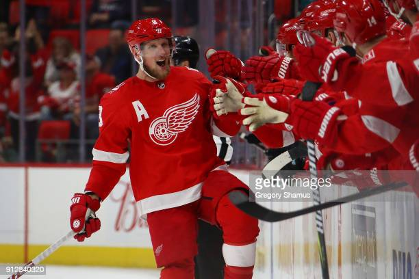 Justin Abdelkader of the Detroit Red Wings celebrates a shootout goal with teammates while playing the San Jose Sharks at Little Caesars Arena on...