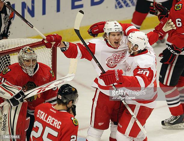 Justin Abdelkader of the Detroit Red Wings celebrates his first period goal with Drew Miller in front of Corey Crawford of the Chicago Blackhawks at...