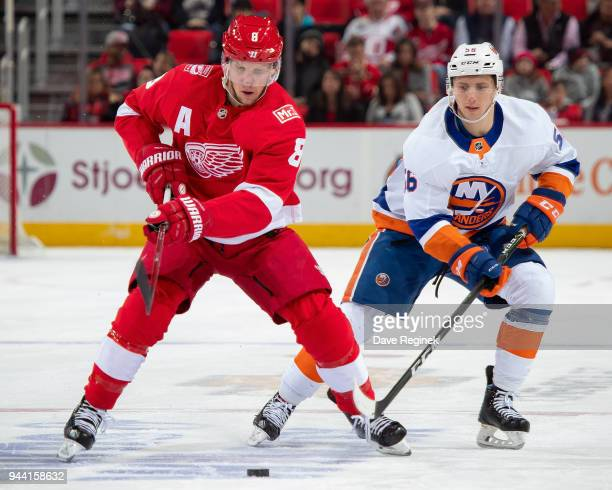 Justin Abdelkader of the Detroit Red Wings controls the puck in front of Tanner Fritz of the New York Islanders during an NHL game at Little Caesars...
