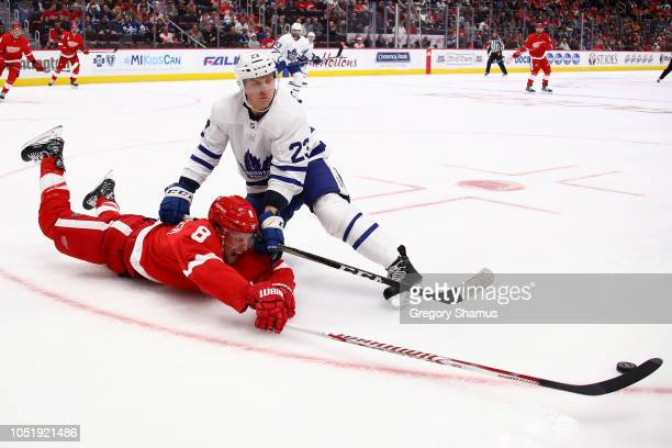 Justin Abdelkader of the Detroit Red Wings dives for the puck past Travis Dermott of the Toronto Maple Leafs during the second period at Little...