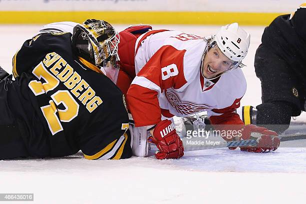 Justin Abdelkader of the Detroit Red Wings falls over Niklas Svedberg of the Boston Bruins in an attempt to score in the second period at TD Garden...