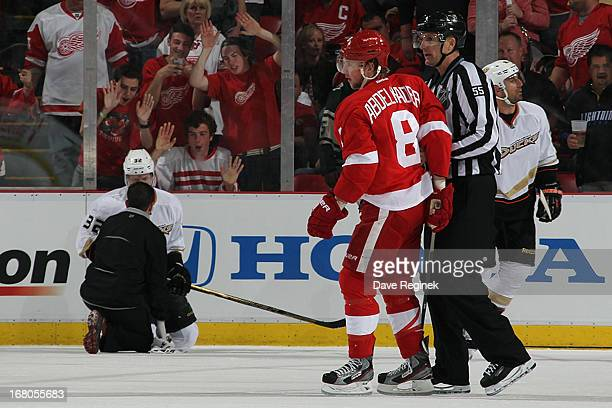 Justin Abdelkader of the Detroit Red Wings led off the ice by linesmen Shane Hayer after getting a 5 minute major and 10 minute misconduct penalty...