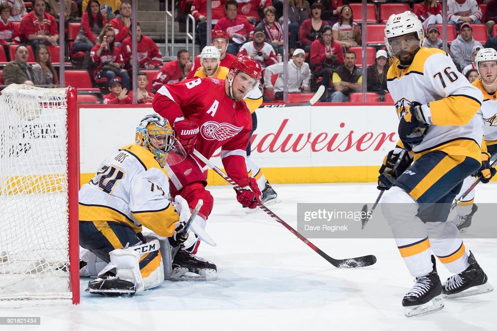 Justin Abdelkader #8 of the Detroit Red Wings looks for a pass in front of goaltender Juuse Saros #74 and P.K. Subban #76 of the Nashville Predators during an NHL game at Little Caesars Arena on February 20, 2018 in Detroit, Michigan. The Predators defeated the Wings 3-2.