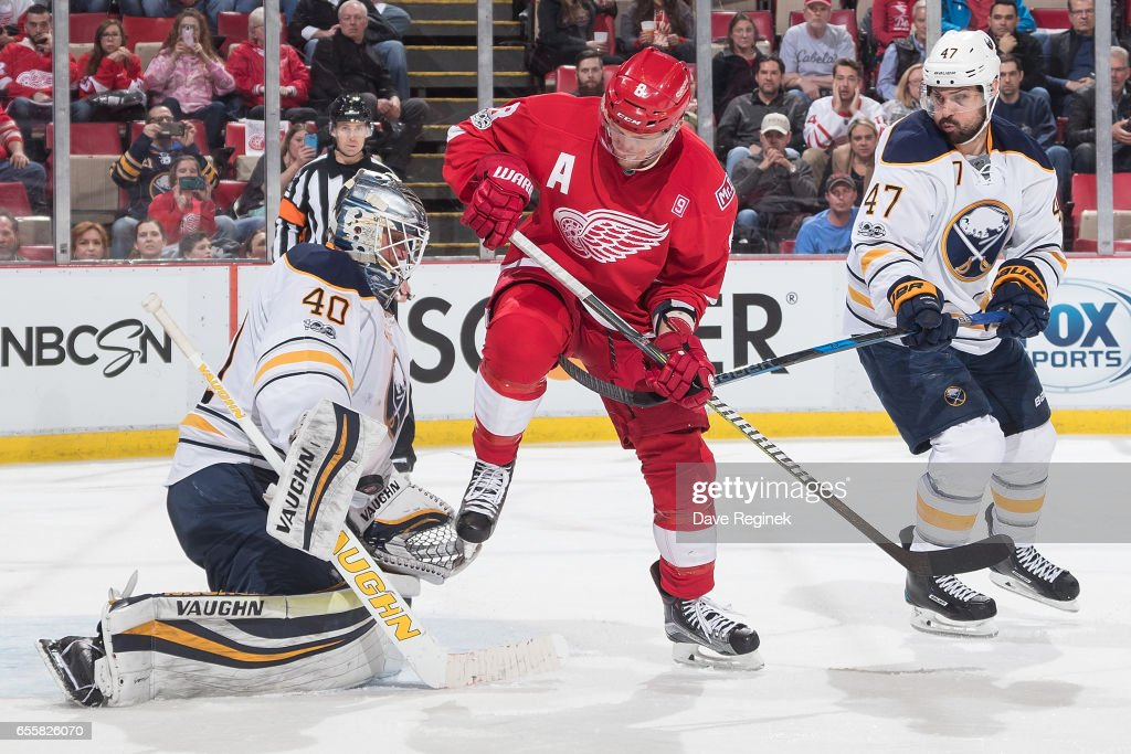 Justin Abdelkader #8 of the Detroit Red Wings looks for the rebound on a save by goaltender Robin Lehner #40 of the Buffalo Sabres as teammate Zach Bogosian #47 follows the play during an NHL game at Joe Louis Arena on March 20, 2017 in Detroit, Michigan. The Sabres defeated the Wings 2-1.