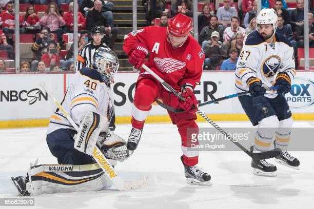 Justin Abdelkader of the Detroit Red Wings looks for the rebound on a save by goaltender Robin Lehner of the Buffalo Sabres as teammate Zach Bogosian...
