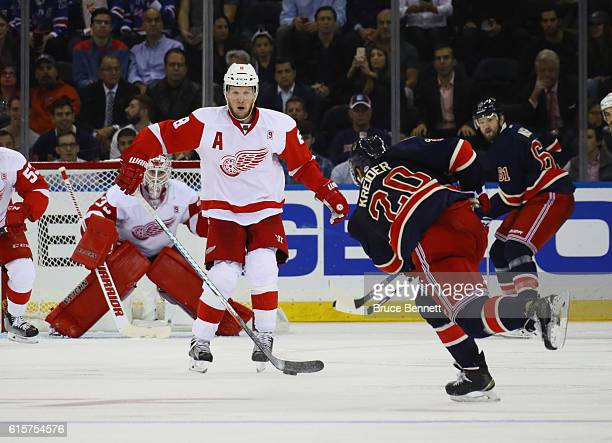 Justin Abdelkader of the Detroit Red Wings looks to block a shot by Chris Kreider of the New York Rangers during the third period at Madison Square...