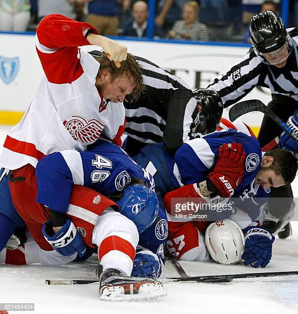 Justin Abdelkader of the Detroit Red Wings punches Michael Blunden of the Tampa Bay Lightning during the third period in Game Two of the Eastern...
