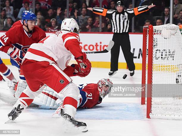 Justin Abdelkader of the Detroit Red Wings scores a goal against the Montreal Canadiens in the NHL game at the Bell Centre on October 21 2014 in...