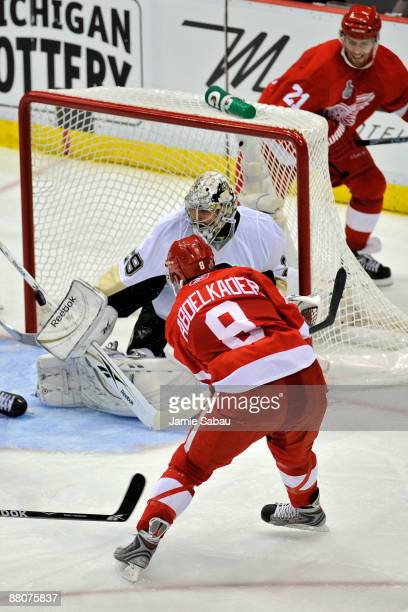 Justin Abdelkader of the Detroit Red Wings scores a goal in the third period against MarcAndre Fleury of the Pittsburgh Penguins during Game 1 of the...