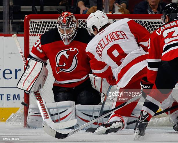 Justin Abdelkader of the Detroit Red Wings scores a powerplay goal at 1252 of the second period against Cory Schneider of the New Jersey Devils at...