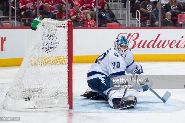 Justin Abdelkader of the Detroit Red Wings scores a third period goal on Louis Domingue of the Tampa Bay Lightning during an NHL game at Little...