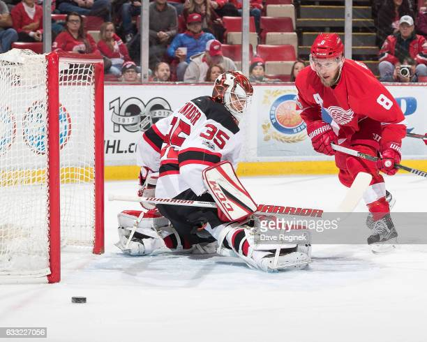 Justin Abdelkader of the Detroit Red Wings skates for a rebound as the puck is shot wide of goaltender Cory Schneider of the New Jersey Devils during...