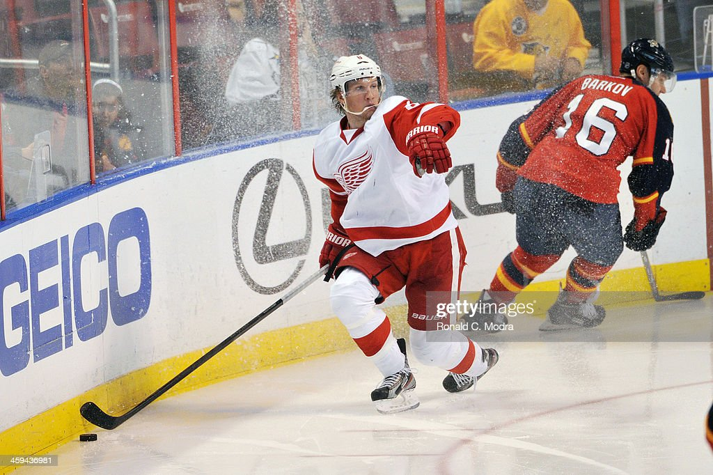Justin Abdelkader of the Detroit Red Wings skates with the puck during a NHL game against the Florida Panthers at the BB&T Center on December 10, 2013 in Sunrise, Florida.