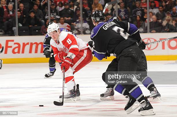 Justin Abdelkader of the Detroit Red Wings skates with the puck against Matt Greene of the Los Angeles Kings on January 7 2010 at Staples Center in...