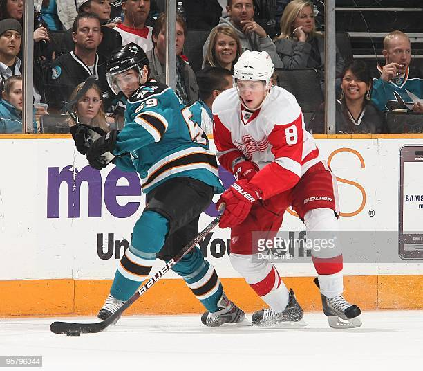 Justin Abdelkader of the Detroit Red Wings steals the puck away from Brad Staubitz of the San Jose Sharks during an NHL game on January 9, 2010 at HP...