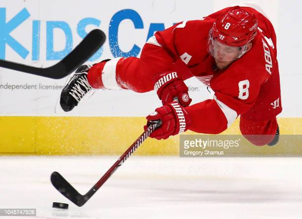 Justin Abdelkader of the Detroit Red Wings tries to control the puck while playing the Columbus Blue Jackets during the second period at Little...
