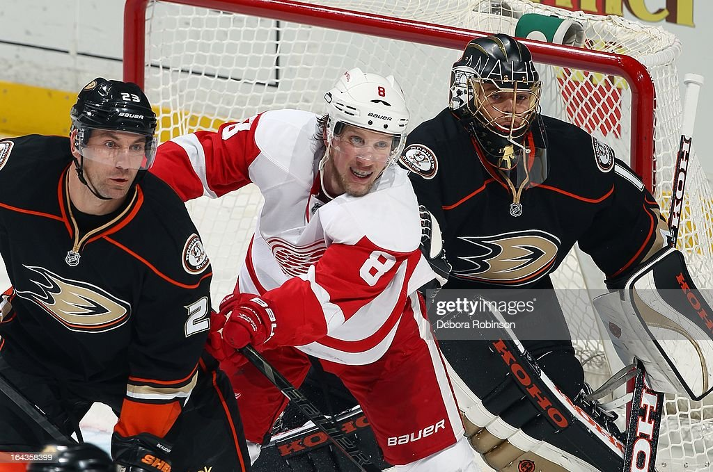 Justin Abdelkader #8 of the Detroit Red Wings works for position to receive a pass in the midst of Ducks defenders Francois Beauchemin #23 and Goalie Jonas Hiller #1 of the Anaheim Ducks. March 22, 2013 at Honda Center in Anaheim, California.