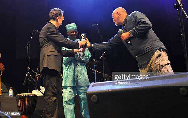 Justin Adams and Juldeh Camara on stage receiving the Songlines Cross-Cultural Collaboration Award from Peter Gabriel during the second day of Womad...