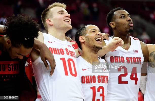 Justin Ahrens, CJ Walker and Andre Wesson of the Ohio State Buckeyes celebrate their 68-59 win over the Indiana Hoosiers at Value City Arena on...