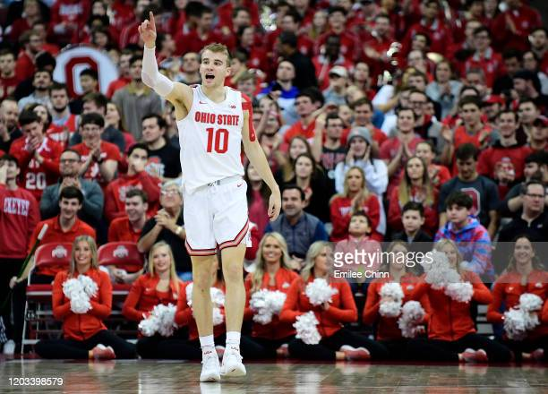 Justin Ahrens of the Ohio State Buckeyes reacts after his three pointer in the second half of their game against the Indiana Hoosiers at Value City...