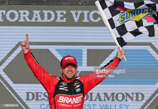Justin Allgaier driver of the BRANDT Professional Agriculture Chevrolet celebrates in Victory Lane after winning the NASCAR Xfinity Series Desert...