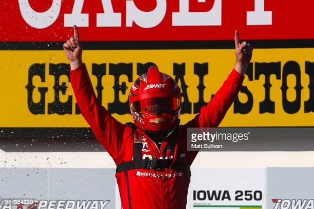 Justin Allgaier driver of the BRANDT Professional Agriculture Chevrolet celebrates in victory lave after winning the NASCAR Xfinity Series Iowa 250...