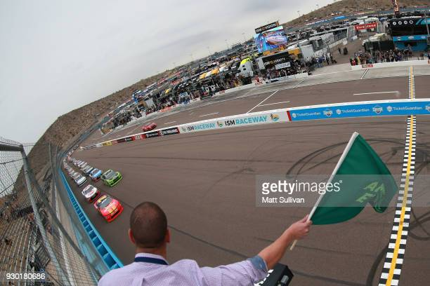 Justin Allgaier driver of the BRANDT Professional Agriculture Chevrolet leads the field to the green flag to start the NASCAR Xfinity Series DC Solar...