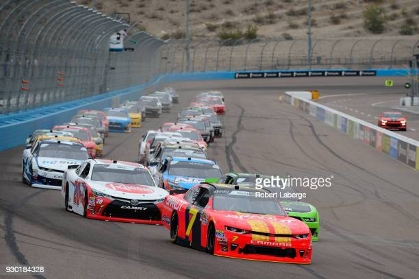 Justin Allgaier driver of the BRANDT Professional Agriculture Chevrolet leads the field past the green flag to start the NASCAR Xfinity Series DC...